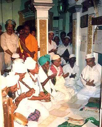 Rifai faqirs recite dua in Khiḍr Maqam, Kataragama Mosque