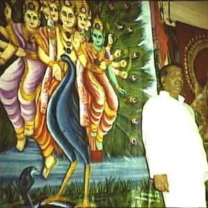 Chief Kapurala Somipala stands before the veil in the Maha Devale